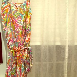 Lilly Pulitzer romper with tie at the waist.